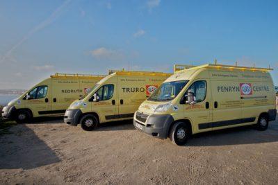 three yellow vans