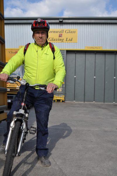 cyclist outside cornwall glass