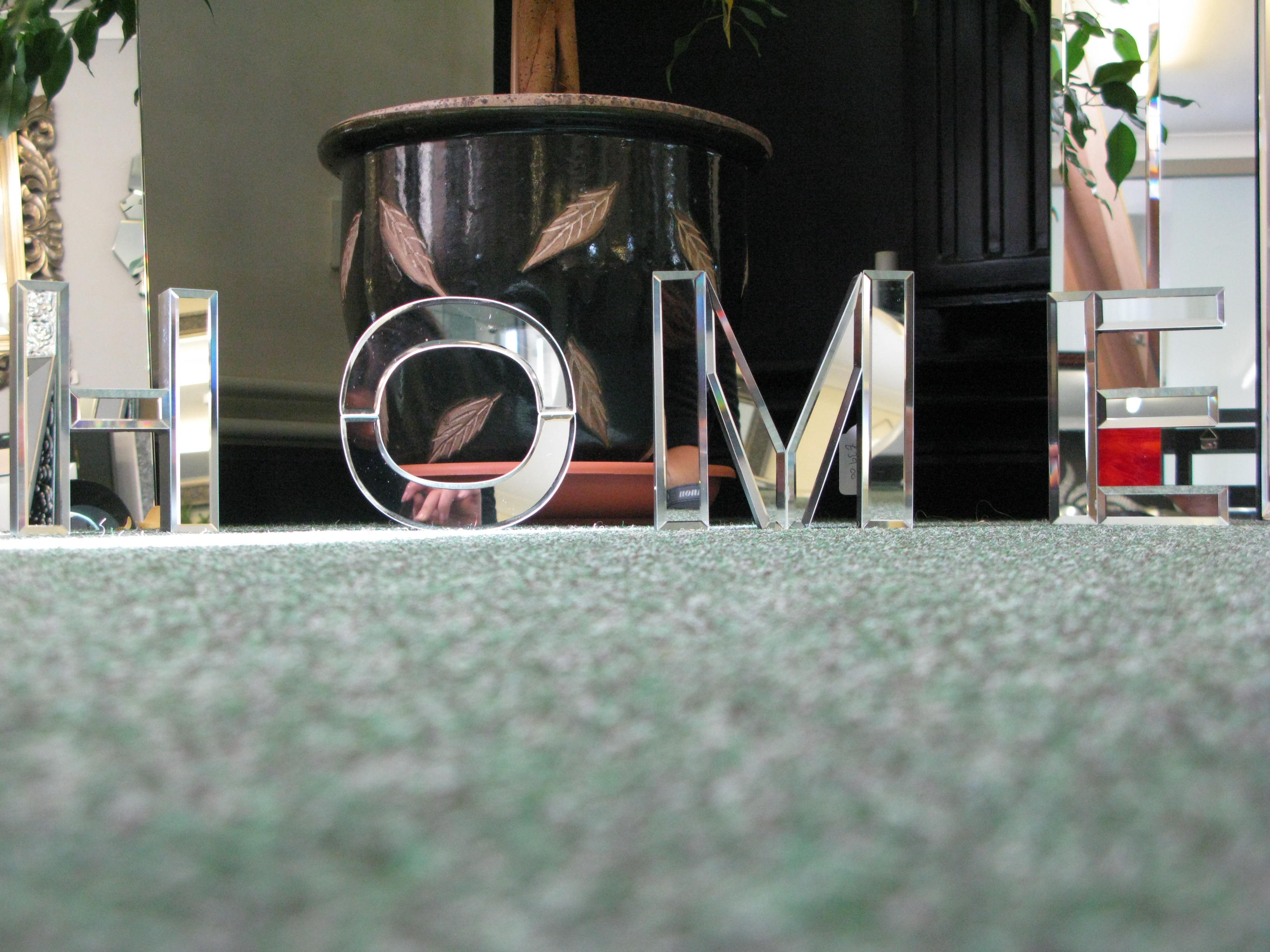 home mirror text on carpet