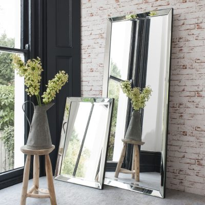 large mirrors against brick wall