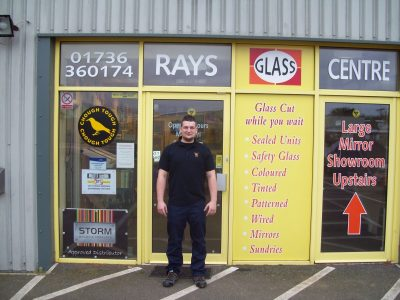 man standing outside rays