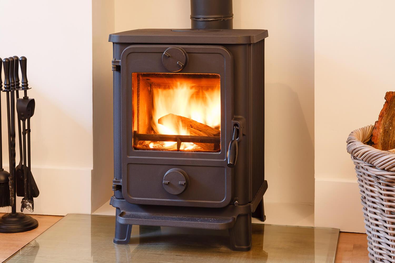 lit fire stove burning