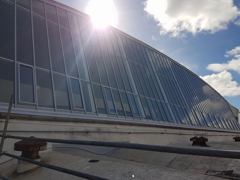 sun over building windows