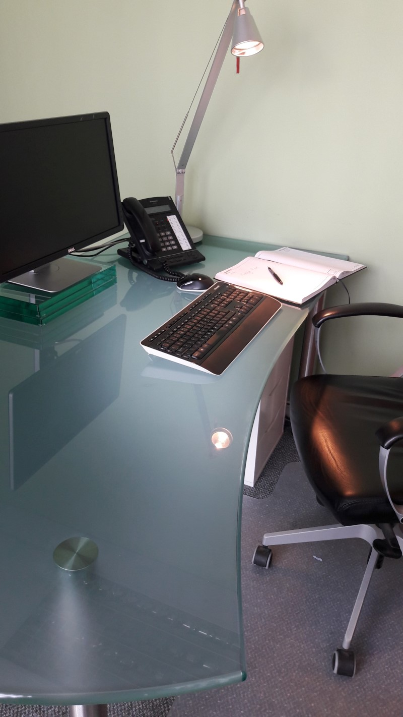 glass desk and computer