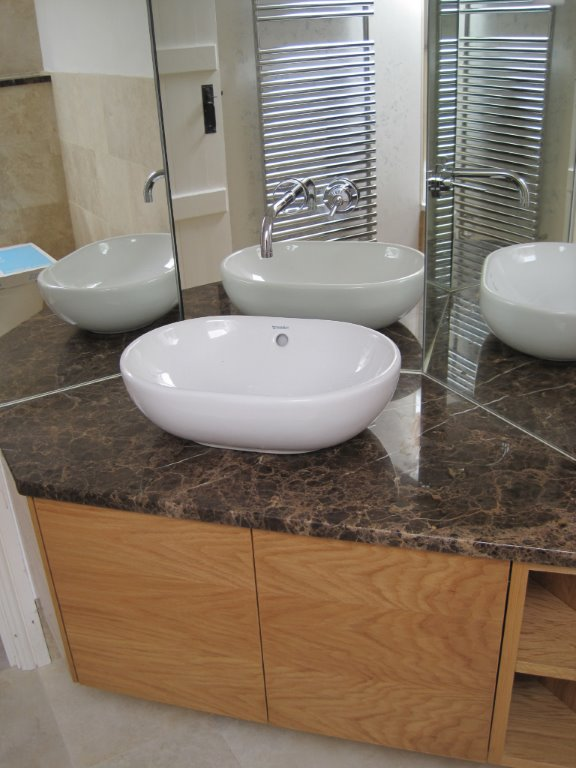 angled mirror and basin