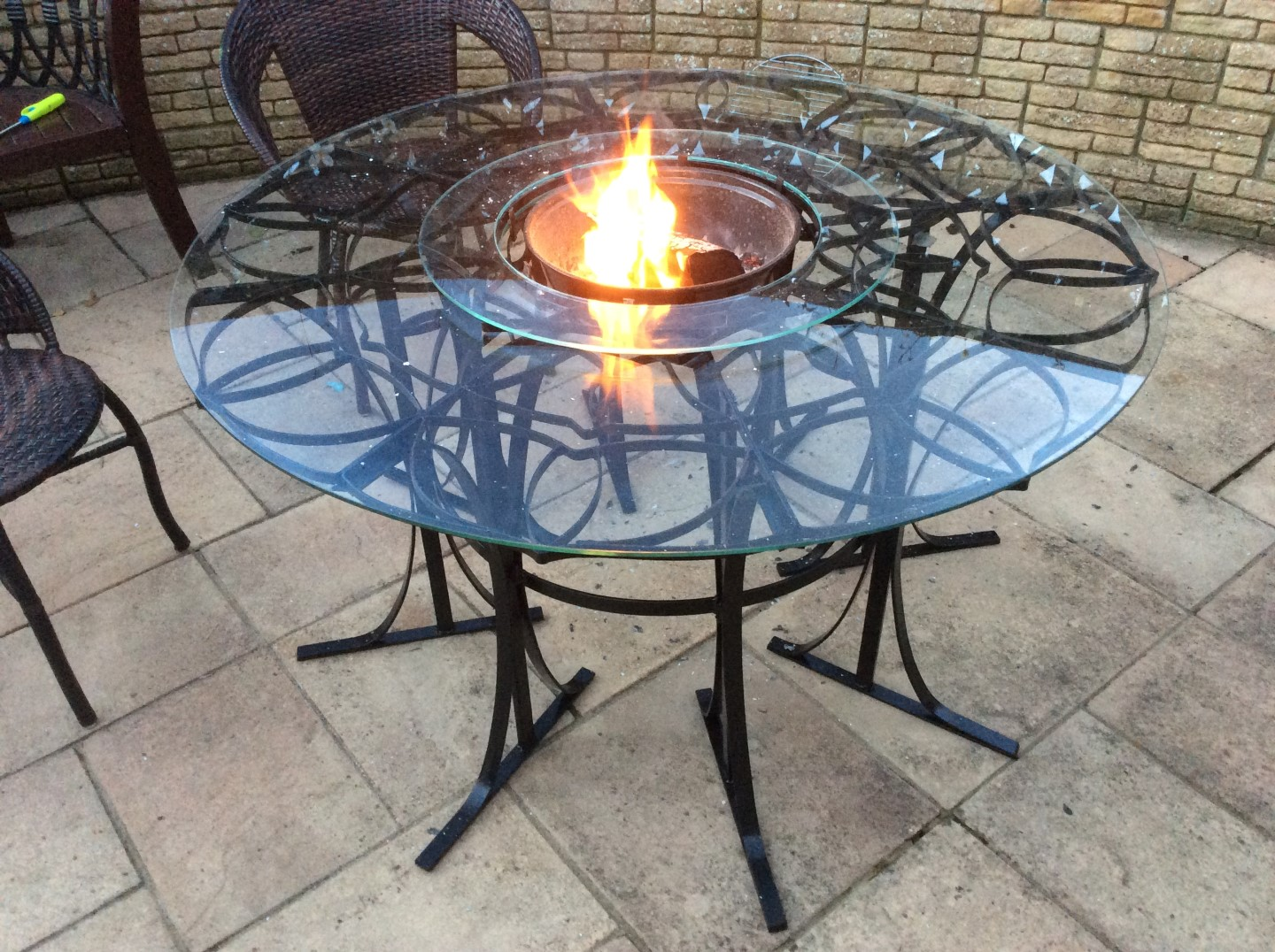 metal and glass fire table