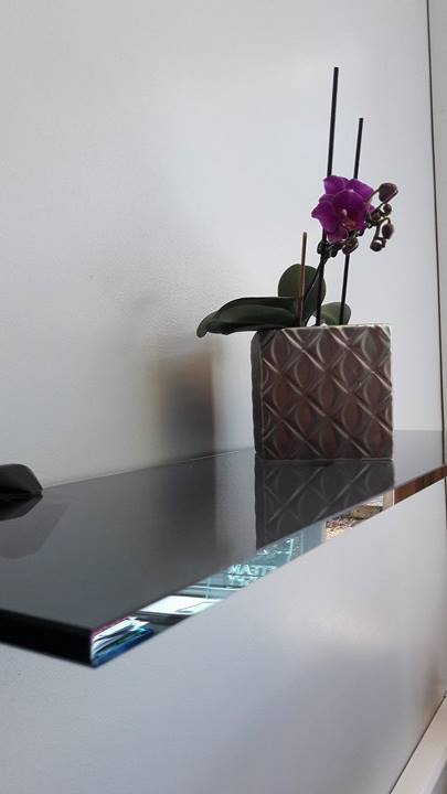 orchid vase on glass shelf
