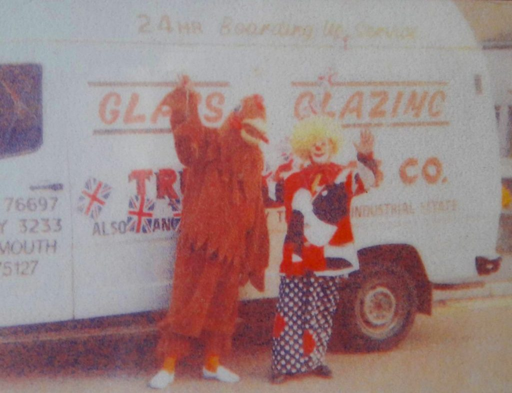 truro glass van with 2 mascots