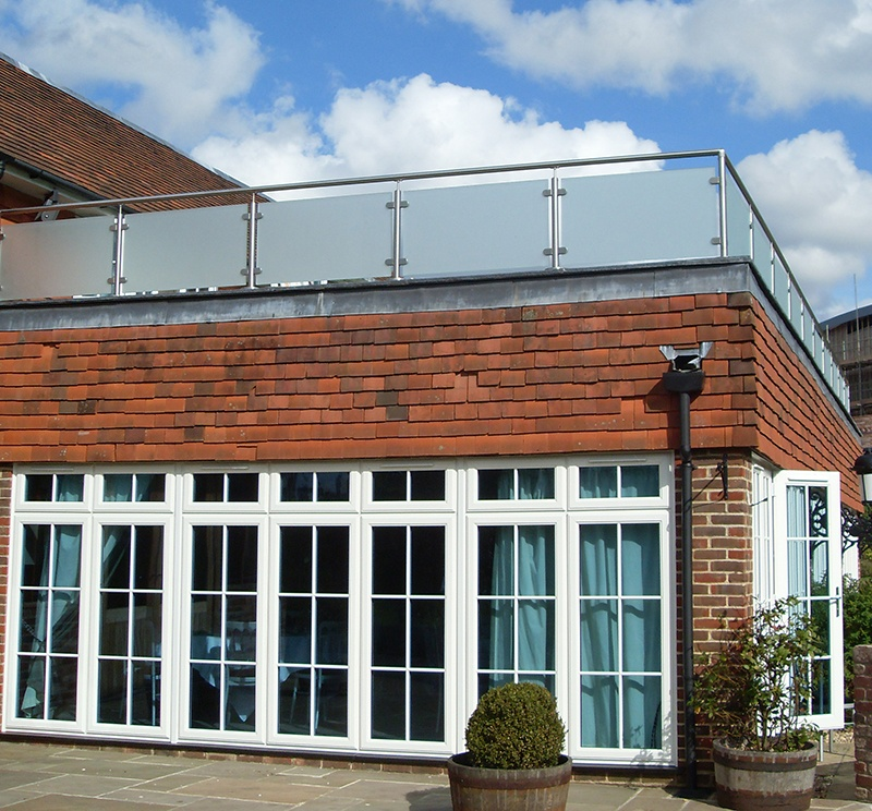house with glass balustrading on rooftop