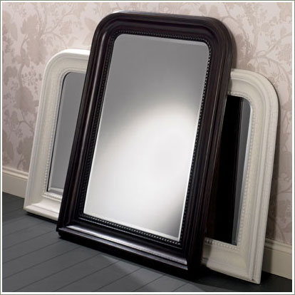 white and black framed mirrors