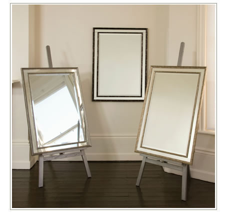 3 mirrors on easels