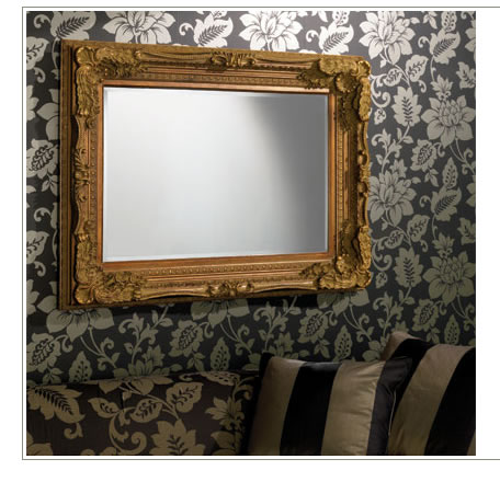 framed mirror on wallpaper