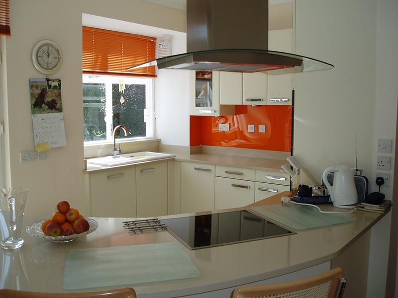 white and orange kitchen