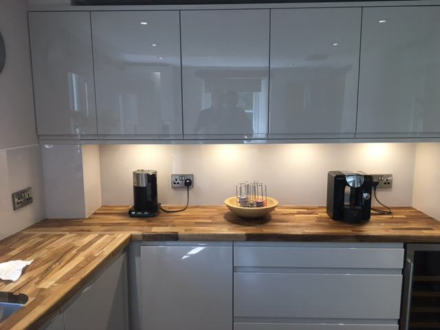 white kitchen cupboards and splashback