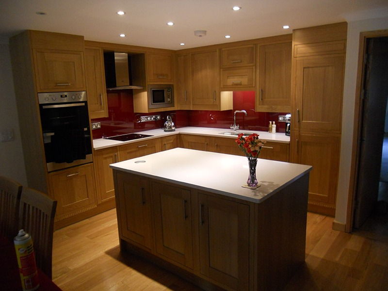 wooden kitchen and red splashback
