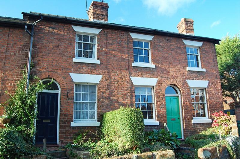 brick house with green door