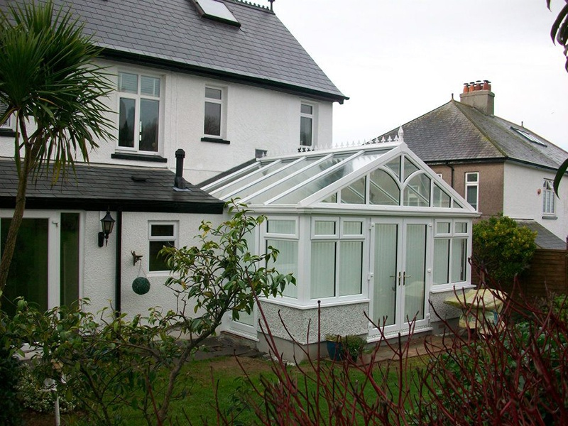 house and glass conservatory