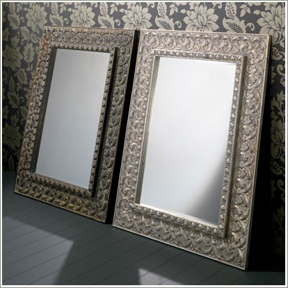 two mirrors against wall