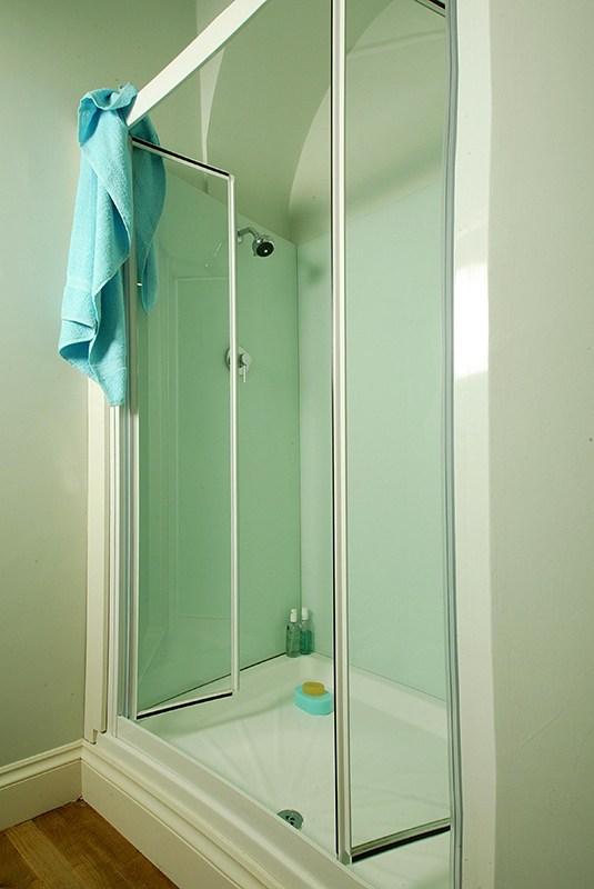 aqua walled bathroom shower
