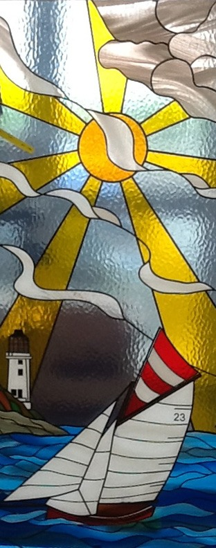 sailing boat and sun stained glass