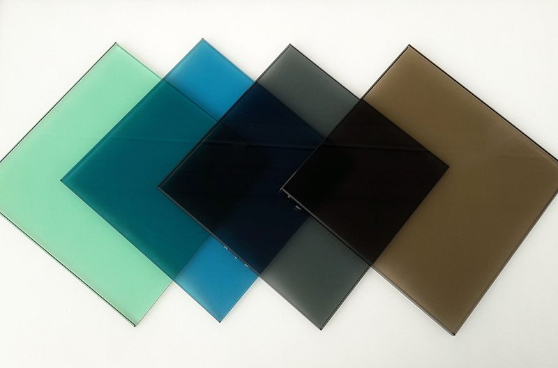 four squares of tinted glass green, blue, grey, bronze